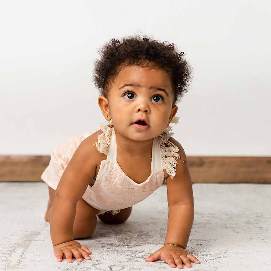 8 month baby girl crawling sitter photo